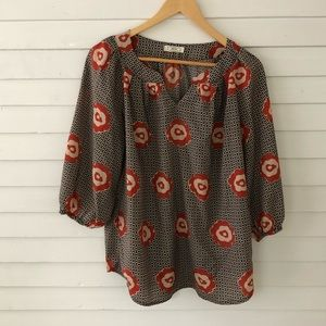 Flowery patterned top with orange floral